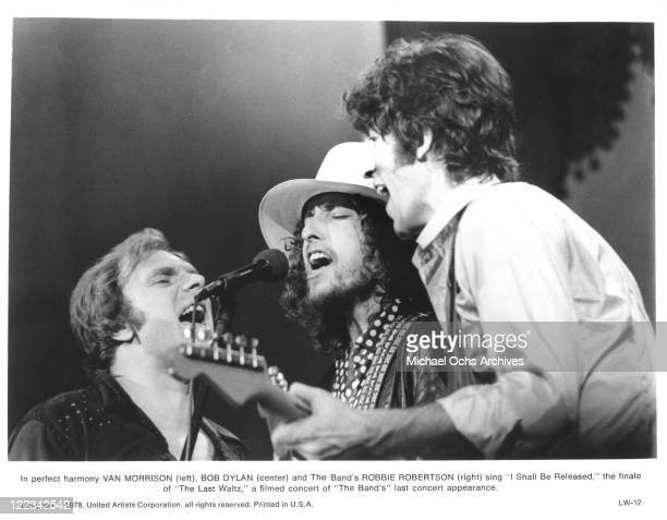 Robbie Robertson of The Band with Van Morrison and Bob Dylan perform at The Band's farewll concert released on film as 'The Last Waltz' at Winterland...