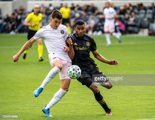 Robbie Robinson of Inter Miami battles Eddie Segura of Los Angeles FC during their MLS match against Inter Miami at the Banc of California Stadium on...