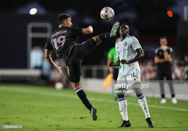 Robbie Robinson of Inter Miami CF kicks the ball up the field against Jhon Espinoza of Chicago Fire FC during the first half at DRV PNK Stadium on...