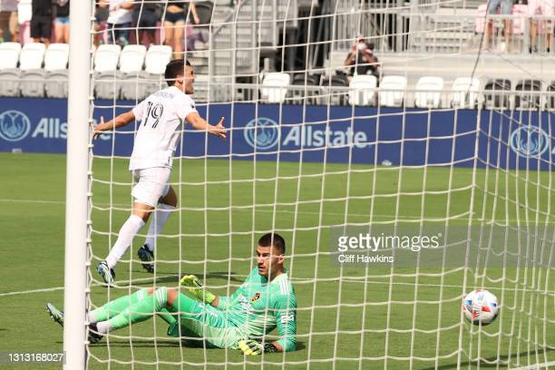 Robbie Robinson of Inter Miami FC scores a goal against Jonathan Bond of Los Angeles Galaxy in the first half at DRV PNK Stadium on April 18, 2021 in...