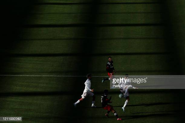 Robbie Robinson of Inter Miami traps the ball in front of Junior Moreno of DC United battle for a loose ball during the first half at Audi Field on...