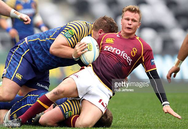 Robbie Robinson of Southland is caught by the Otago defence during the round seven ITM Cup match between Otago and Southland at Forsyth Barr Stadium...