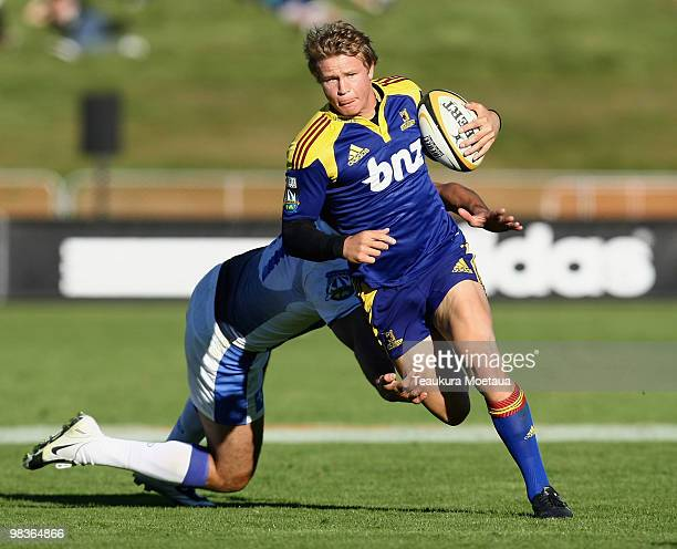 Robbie Robinson of the Highlanders makes a break during the round nine Super 14 match between the Highlanders and the Western Force at on April 10...