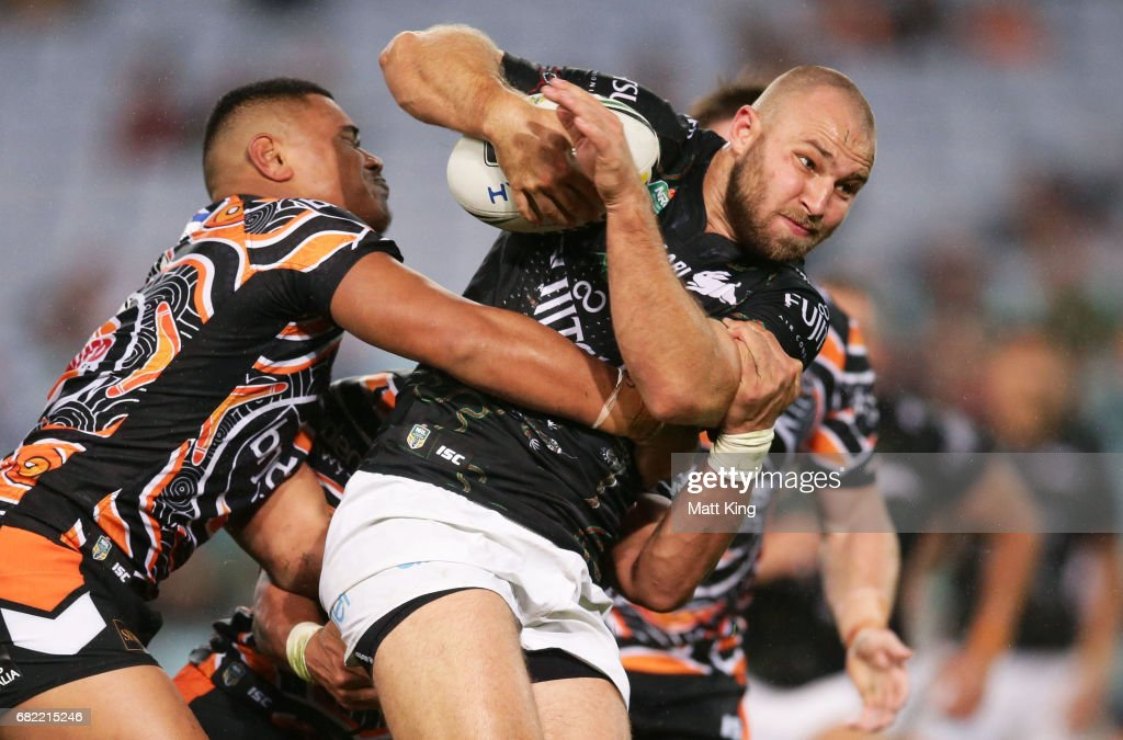 Robbie Rochow of the Rabbitohs is tackled during the round ten NRL match between the Wests Tigers and the South Sydney Rabbitohs at ANZ Stadium on May 12, 2017 in Sydney, Australia.