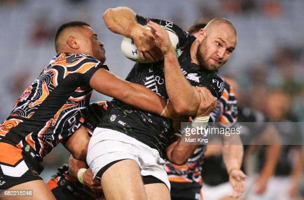 Robbie Rochow of the Rabbitohs is tackled during the round ten NRL match between the Wests Tigers and the South Sydney Rabbitohs at ANZ Stadium on...