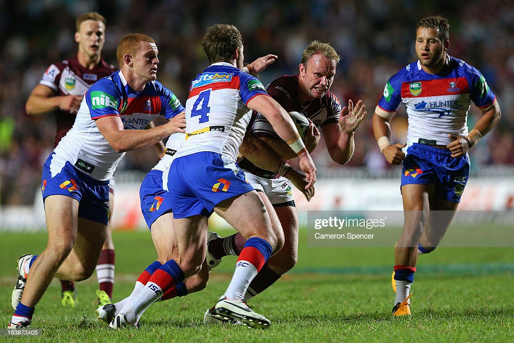 Robbie Rochow of the Sea Eagles is tackled during the round two NRL match between the Manly Sea Eagles and the Newcastle Knights at Brookvale Oval on March 17, 2013 in Sydney, Australia.