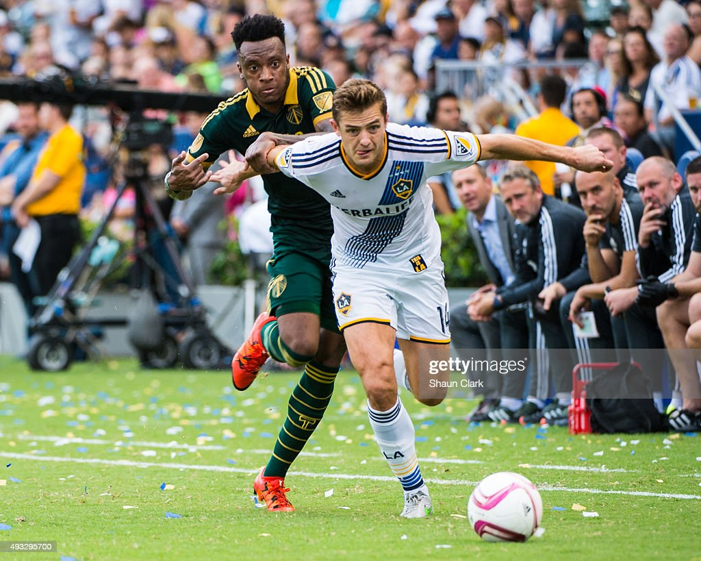 Robbie Rogers #14 of Los Angeles Galaxy battles Rodney Wallace #22 of Portland Timbers during Los Angeles Galaxy's MLS match against Portland Timbers at the StubHub Center on October 18, 2015 in Carson, California. The Portland Timbers won the match 5-2