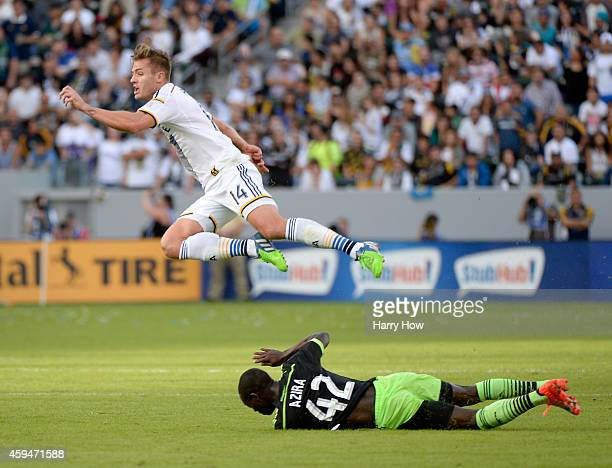 Robbie Rogers of Los Angeles Galaxy is tripped by Micheal Azira of Seattle Sounders FC during the Western Conference Final at StubHub Center on...