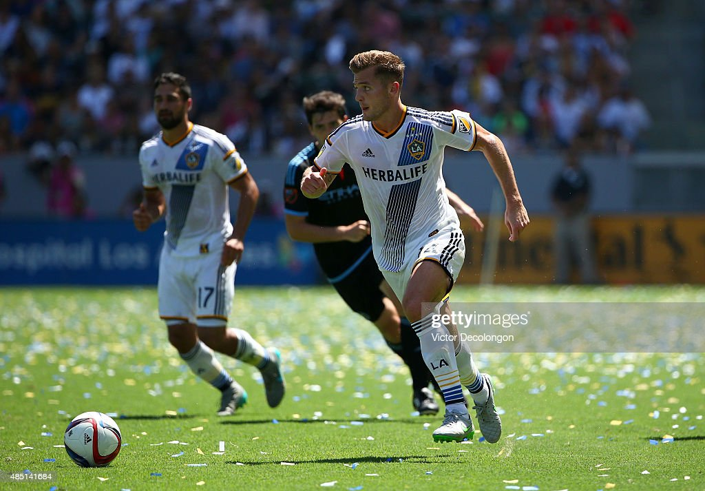 Robbie Rogers #14 of Los Angeles Galaxy paces the ball on the attack in the second half during the MLS match against the New York City FC at StubHub Center on August 23, 2015 in Los Angeles, California. The play resulted in Rogers going on to assist on a goal by teammate Robbie Keane. The Galaxy defeated NYCFC
