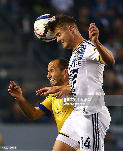 Robbie Rogers of Los Angeles Galaxy wins a header against Nick LaBrocca of the Colorado Rapids in the first half during the MLS match at StubHub...