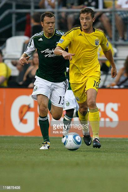 Robbie Rogers of the Columbus Crew and Jack Jewsbury of the Portland Timbers chase after a loose ball on July 23 2011 at Crew Stadium in Columbus Ohio
