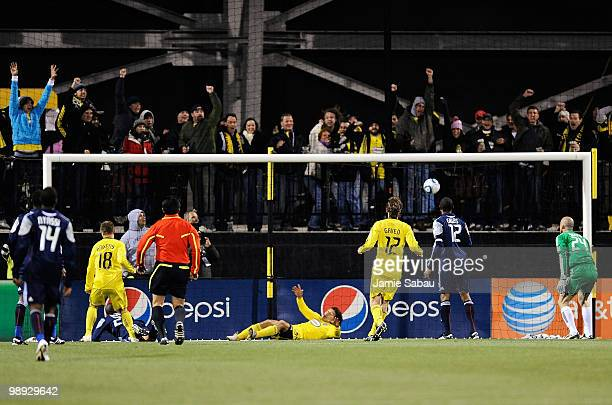 Robbie Rogers of the Columbus Crew scores the game winning goal in extra time against the New England Revolution on May 8 2010 at Crew Stadium in...