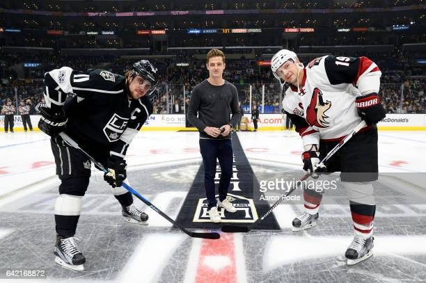 Robbie Rogers of the LA Galaxy participates in the ceremonial puck drop with Anze Kopitar of the Los Angeles Kings and Shane Doan of the Arizona...