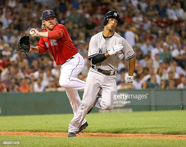 Robbie Ross Jr #28 of the Boston Red Sox makes the play on Cole Figueroa of the New York Yankees in the sixth inning at Fenway Park on July 10 2015...