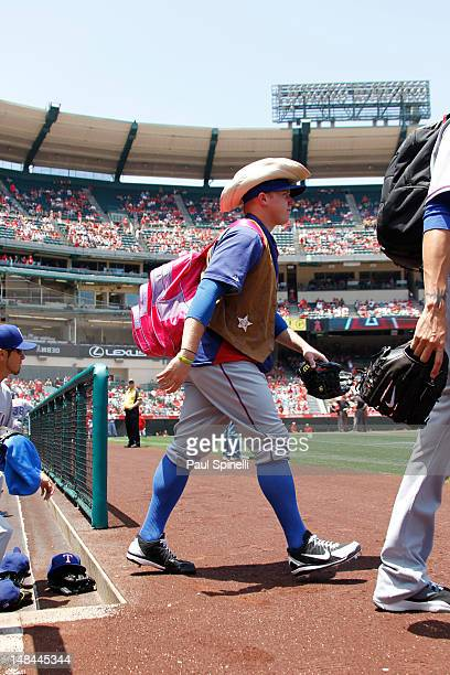 Robbie Ross of the Texas Rangers carries a pink backpack as part of rookie hazing before the game against the Los Angeles Angels of Anaheim on June 3...
