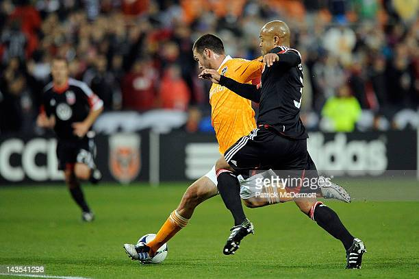 Robbie Russell of DC United battles with Will Bruin of the Houston Dynamo at RFK Stadium on April 28 2012 in Washington DC