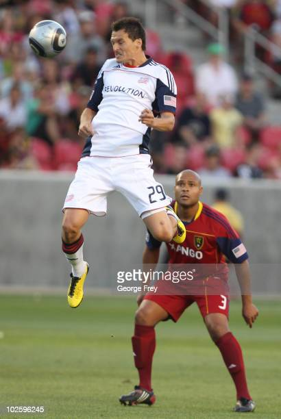 Robbie Russell of Real Salt Lake looks on as Marko Perovic of the New England Revolution heads the ball during the first half of an MLS soccer game...