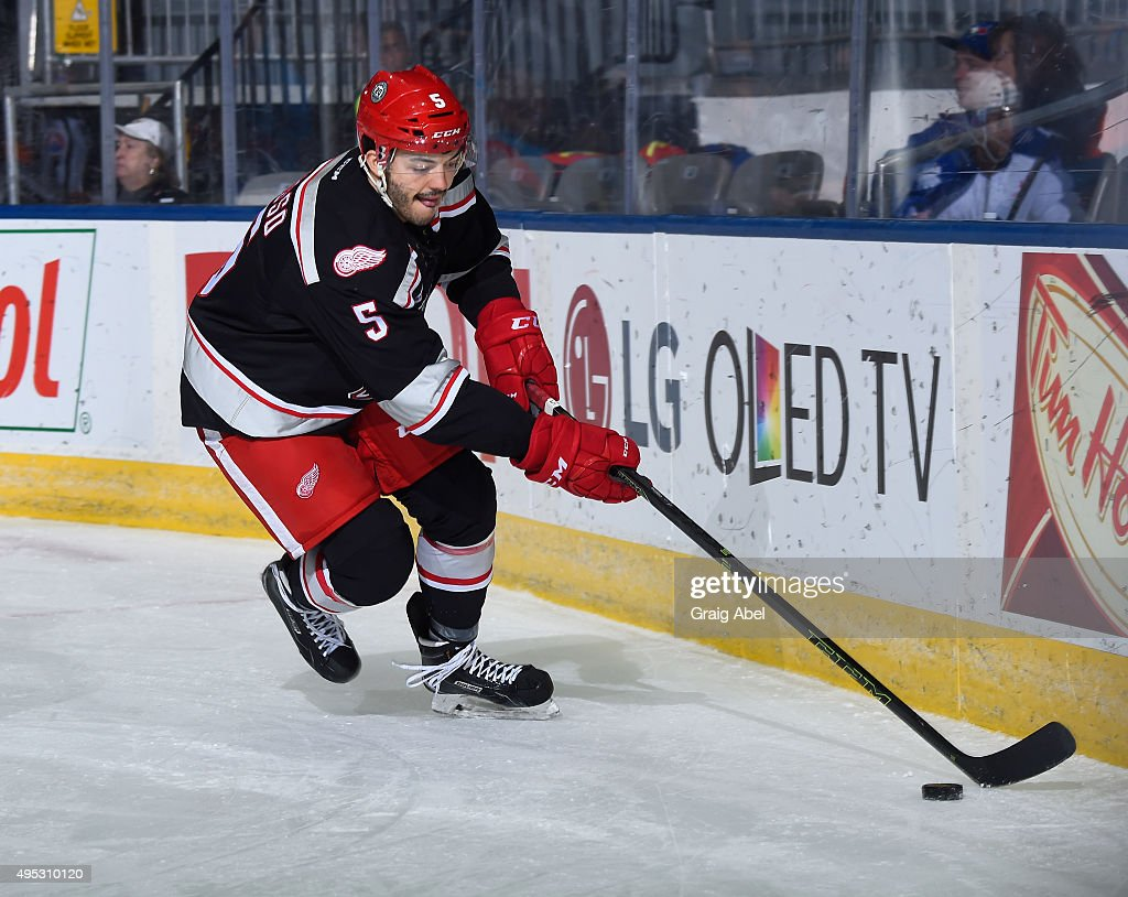 Robbie Russo #5 of the Grand Rapids Griffins controls the puck against the Toronto Marlies during AHL game action on October 30, 2015 at Ricoh Coliseum in Toronto, Ontario, Canada.