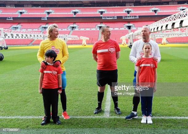 Robbie Savage Graham Poll and Alan Shearer attend 'The Battle of the Backsides' photocall at Wembley Stadium on March 10 2014 in London England Alan...
