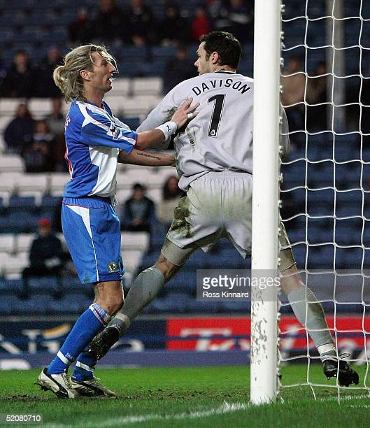 Robbie Savage of Blackburn challenges Aidan Davison of Colchester during the FA Cup forth round tie between Blackburn Rovers and Colchester United at...