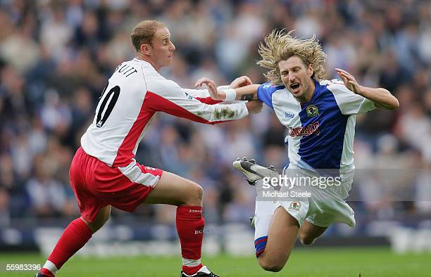 Robbie Savage of Blackburn is fouled by Nicky Butt during the Barclays Premiership match between Blackburn Rovers and Birmingham City at Ewood Park...