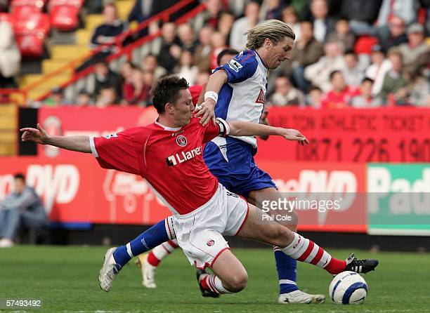 Robbie Savage of Blackburn is tackled by Charlton's Matt Holland during the Barclays Premiership match between Charlton Athletic and Blackburn Rovers...