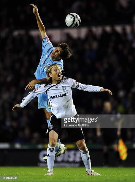 Robbie Savage of Derby battles with Jack Cork of Coventry during the CocaCola Championship match between Derby County and Coventry City at Pride Park...