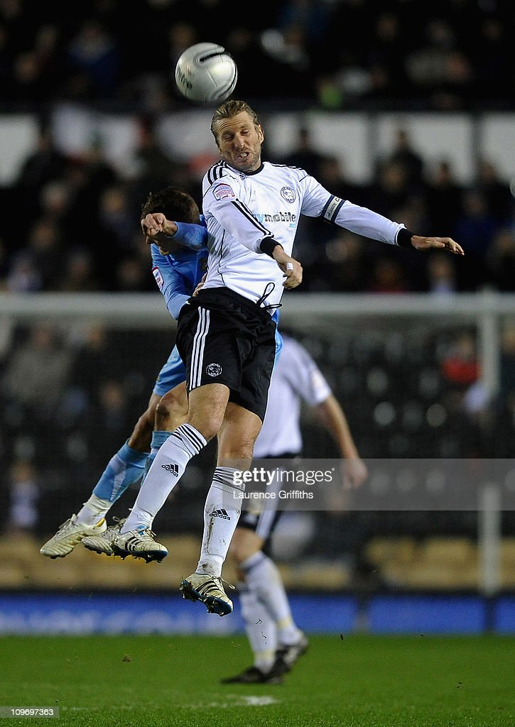 Robbie Savage of Derby County battles with Dean Shiels of Doncaster Rovers during the npower Championship match between Derby County and Doncaster Rovers at Pride Park on March 1, 2011 in Derby, England.
