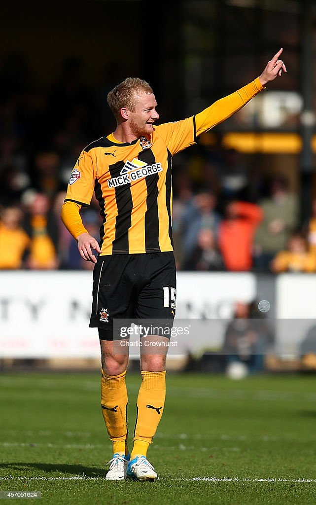 Robbie Simpson of Cambridge celebrates after scoring the teams fifth goal during the Sky Bet League Two match between Cambridge United and Oxford United at The Abbey Stadium on October 11, 2014 in Cambridge, England.