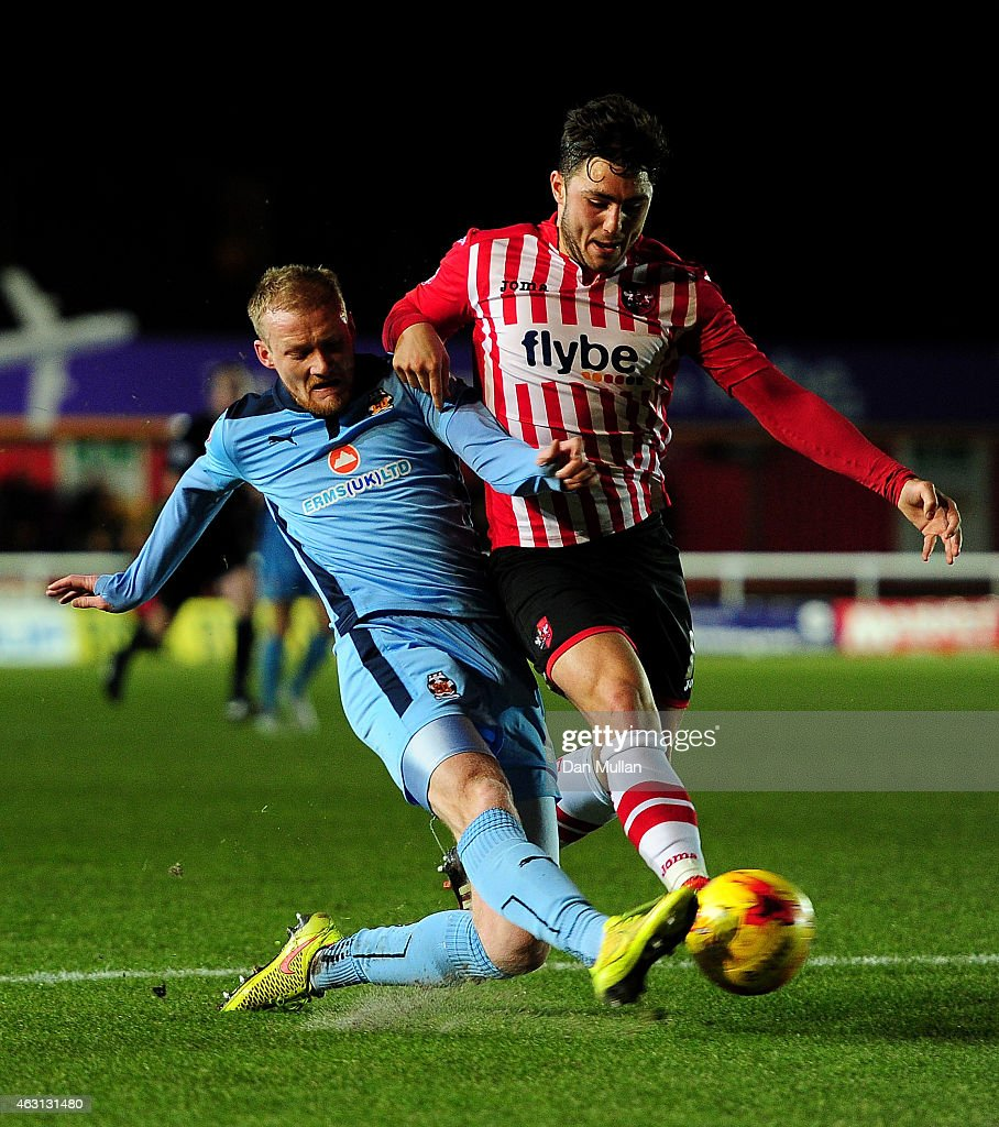 Robbie Simpson of Cambridge United (L) battles for the ball with Jordan Moore-Taylor of Exeter City during the Sky Bet League Two match between Exeter City and Cambridge United at St. James Park on February 10, 2015 in Exeter, England.