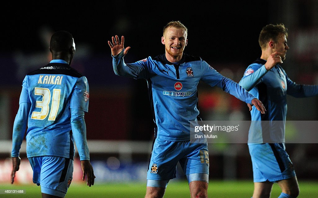 Robbie Simpson of Cambridge United (c) celebrates scoring his side's opening goal during the Sky Bet League Two match between Exeter City and Cambridge United at St. James Park on February 10, 2015 in Exeter, England.