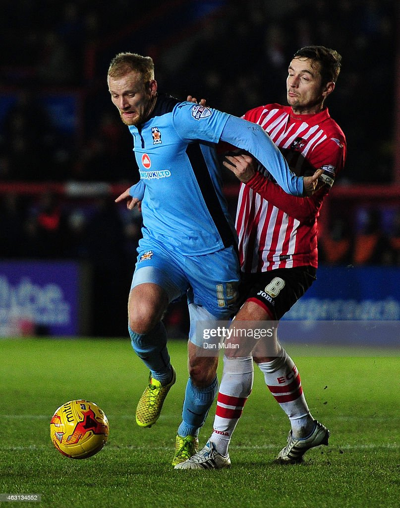 Robbie Simpson of Cambridge United holds off Matt Oakley of Exeter City during the Sky Bet League Two match between Exeter City and Cambridge United at St. James Park on February 10, 2015 in Exeter, England.