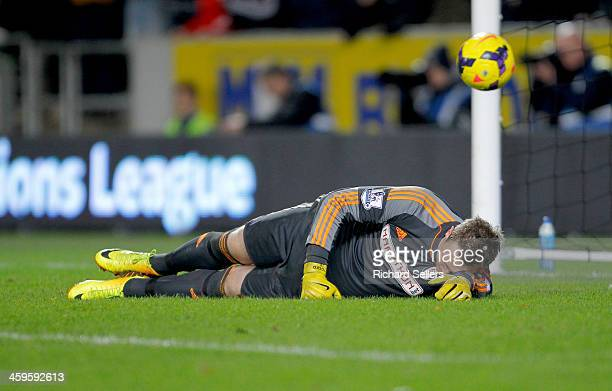 Robbie Stockdale of Fulham lies beaten after Hull City score their 3rd goal during the Barclays Premier League match between Hull City and Fulham at...