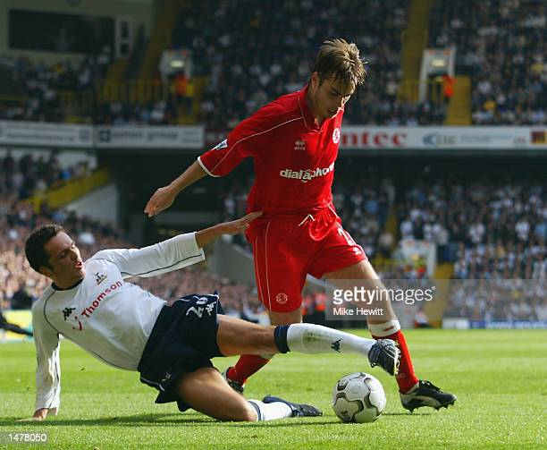 Robbie Stockdale of Middlesbrough is tackled by Matthew Etherington of Tottenham Hotspur during the FA Barclaycard Premiership match held on...