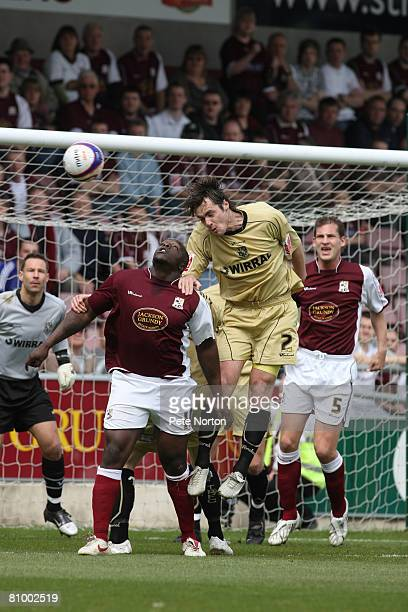 Robbie Stockdale of Tranmere Rovers heads the ball under pressure from Adebayo Akinfenwa of Northampton Town during the Coca Cola League One Match...
