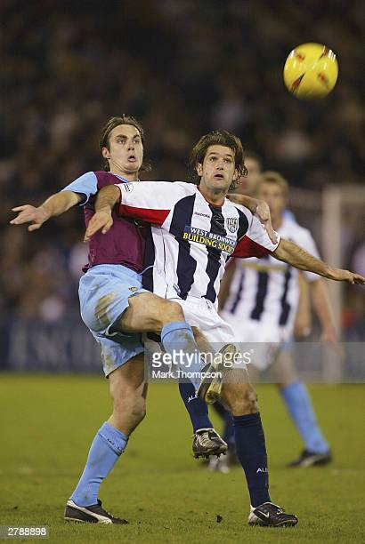 Robbie Stockdale of West Ham battles with Andy Johnson of West Bromwich during the Nationwide Division One match between West Bromwich Albion and...