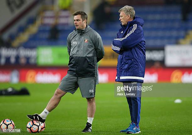 Robbie Stockdale Sunderland first team coach speaks to David Moyes Manager of Sunderland on the pitch prior to the Emirates FA Cup third round replay...