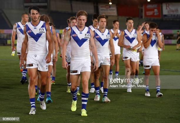 Robbie Tarrant and Jack Ziebell of the Kangaroos leave the field after a loss during the AFL 2018 JLT Community Series match between the Richmond...
