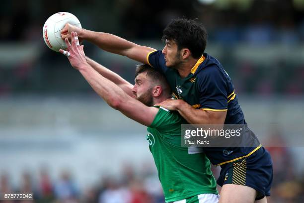 Robbie Tarrant of Australia spoils the mark for Aidan O'Shea of Ireland during game two of the International Rules Series between Australia and...