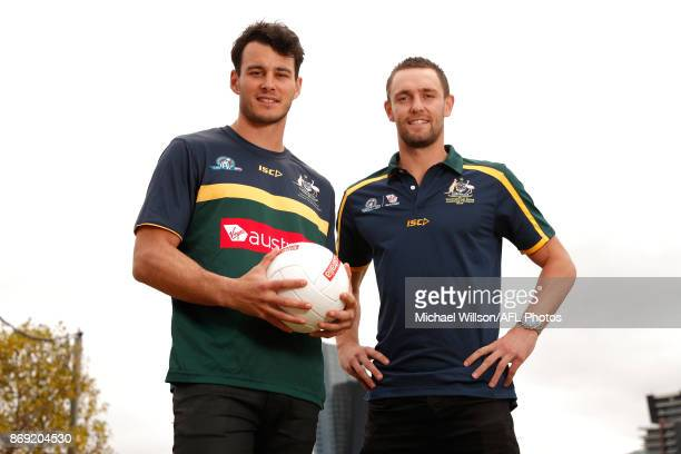 Robbie Tarrant of the Kangaroos and Jack Gunston of the Hawks pose for a photograph during a Australia International Rules Media Opportunity at AFL...