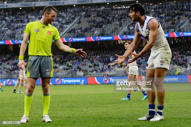 Robbie Tarrant of the Kangaroos argues with the umpire during the round 10 AFL match between the Fremantle Dockers and the North Melbourne Kangaroos...