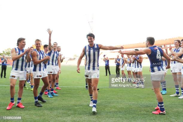 Robbie Tarrant of the Kangaroos celebrates victory with team mates after the round 2 AFL match between the Greater Western Sydney Giants and the...
