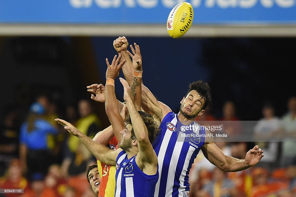Robbie Tarrant of the Kangaroos competes for the ball during the round five AFL match between the Gold Coast Suns and the North Melbourne Kangaroos at Metricon Stadium on April 23, 2016 in Gold Coast, Australia.