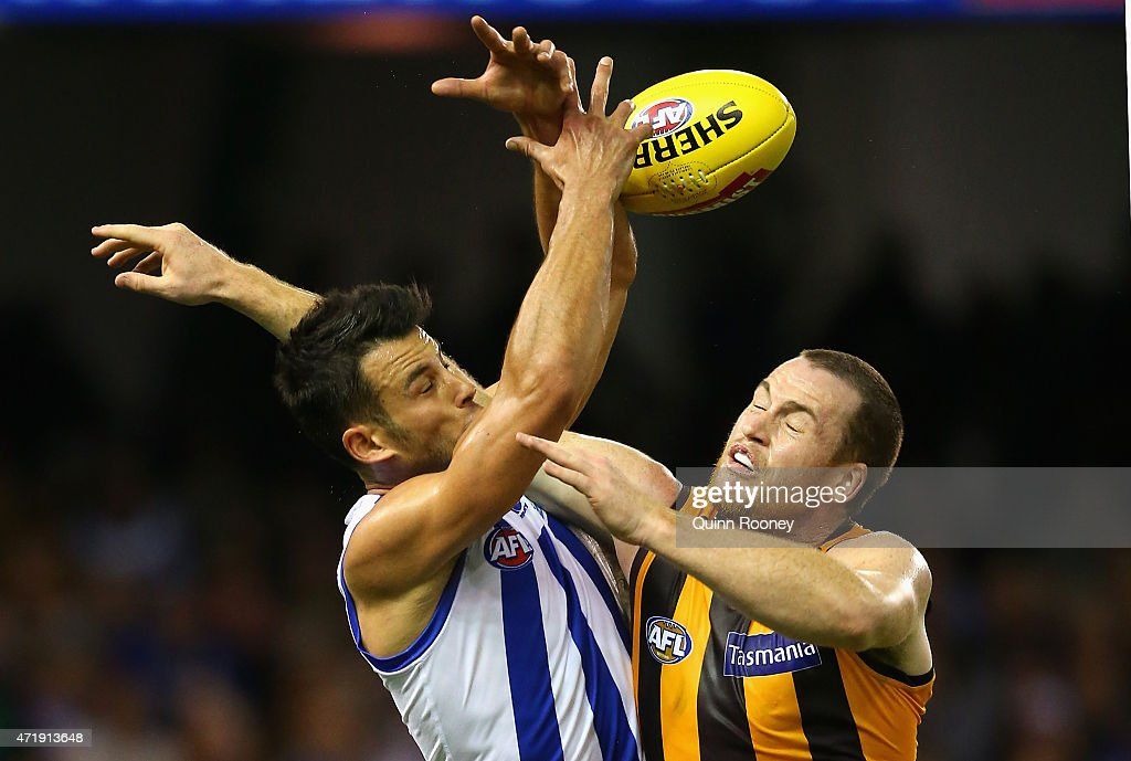 Robbie Tarrant of the Kangaroos marks infront of Jarryd Roughead of the Hawks during the round five AFL match between the North Melbourne Kangaroos and the Hawthorn Hawks at Etihad Stadium on May 2, 2015 in Melbourne, Australia.