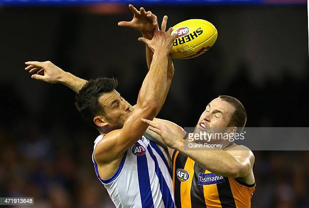 Robbie Tarrant of the Kangaroos marks infront of Jarryd Roughead of the Hawks during the round five AFL match between the North Melbourne Kangaroos...