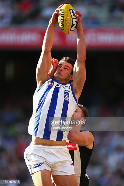 Robbie Tarrant of the Kangaroos marks infront of Nathan Brown of the Magpies during the round 23 AFL match between the Collingwood Magpies and the...