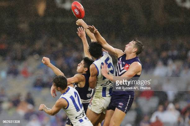 Robbie Tarrant of the Kangaroos spoils during the round 10 AFL match between the Fremantle Dockers and the North Melbourne Kangaroos at Optus Stadium...