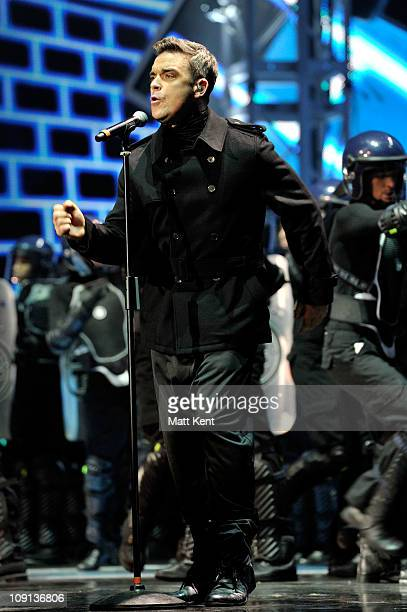 Robbie Wiilliams of Take That performs on stage at The BRIT Awards 2011 at O2 Arena on February 15 2011 in London England