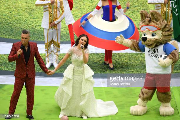 Robbie Williams and Aida Garifullina perform as Mascot Zabivaka the Wolf looks on during the opening ceremony prior to the 2018 FIFA World Cup Russia...