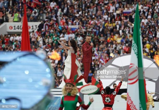 Robbie Williams and Aida Garifullina perform during the Opening Ceremony during the 2018 FIFA World Cup Russia group A match between Russia and Saudi...